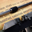 Stock Photo: Classified document on typewriter