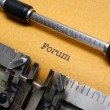 Forum text on typewriter - Stock Photo