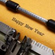 Happy new year text on typewriter — Stock Photo