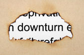 Downturn text on paper hole — Stock Photo
