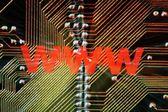 Web and circuit board — Stock Photo