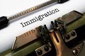 Immigration text on typewriter — Stock Photo