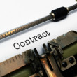 Contract on typewriter — Stock Photo