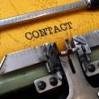 Stock Photo: Contact on typewriter