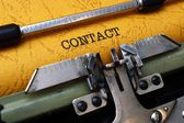 Contact on typewriter — Stock Photo