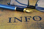 Pen on info text — Stock Photo