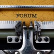 Forum text on typewriter — Stock Photo