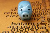 Piggy bank on balance account money — Stock Photo
