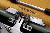 Customer text on typewriter — Stock Photo