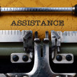 Assistance text on typewriter — Stock Photo #34100701
