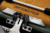 Information text on typewriter — Stock Photo