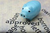 Loan approved and piggy bank — Stock Photo
