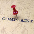 Push pin on complaint text — Stock Photo