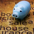Sale house and piggy bank concept — Stock Photo