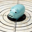 Stock Photo: Piggy bank on target concept