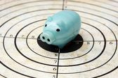Piggy bank on target concept — Stock Photo