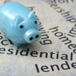Piggy bank and real estate concept — Stock Photo