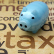 Piggy bank and tax concept — Stock Photo
