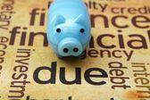 Piggy bank and due concept — Stok fotoğraf