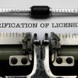 Stock Photo: Verification of license on typewriter