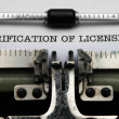 Verification of license on typewriter — Stockfoto
