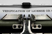 Verification of license on typewriter — Stock Photo