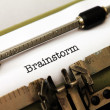 Stock Photo: Brainstorm text on typewriter
