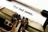 Bad news on typewriter — Stock Photo