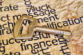 Finance and golden key — Stock Photo