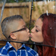Mother and Son Lightly Kiss Under Umbrella - Stock Photo