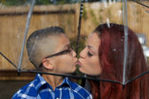 Mother and Son Lightly Kiss Under Umbrella — 图库照片