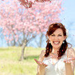 Bride Showered by Cherry Blossom Petals — Stock Photo #24877013