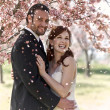 Couple Showered with Cherry Blossoms — Stock Photo