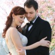 Young Bride and Groom Embrace - Stock Photo