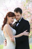 Young Bride and Groom Embrace — Stock Photo