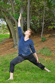 Man Performs Reverse Warrior Yoga Pose in Park — Stock Photo