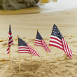 Four American Flags in Sand — Stock Photo #26955809
