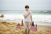 Young Boy Pledges Allegiance to American Flag — Stock Photo