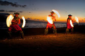 Fire Dancers at Dusk on the Beach — Stock Photo