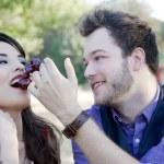 Man Feeds Woman Grapes — Stock Photo