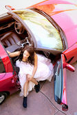 Glamorous Young Woman Getting Out of Red Sports Car — Stock Photo