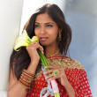 Indian Woman Holding Calla Lilies — Stock Photo