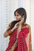 Indian Woman Talks on Cell Phone — Stock Photo