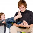 Older brother is tickling the young one - Foto de Stock