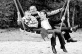 Having fun on the swing — Stock Photo