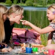 Young girl feeds her mother — Stock Photo