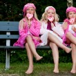 3 Sisters eating a lollipop — Stock Photo