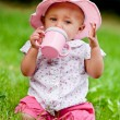 Baby is drinking on 1st birthday — Stock Photo #12590148