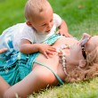 Crawling on mothers chest — Stock Photo