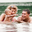Happy family in the water — Stock Photo